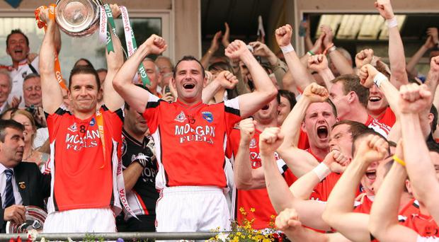 Paul McGrane (left) says the loss of Stevie McDonnell (right) and other key men is a massive blow for Armagh