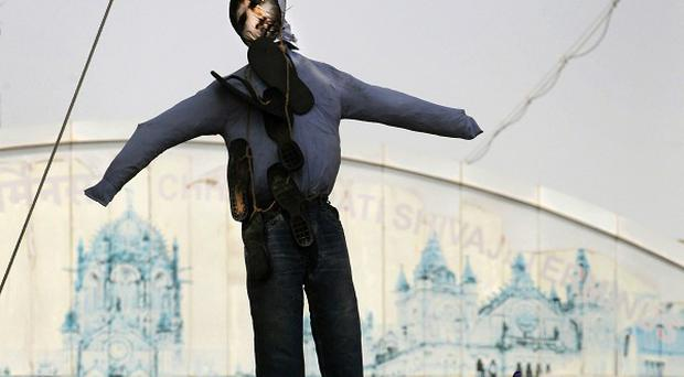 Indians hang an effigy of Mohammed Ajmal Kasab as they celebrate his execution (AP)