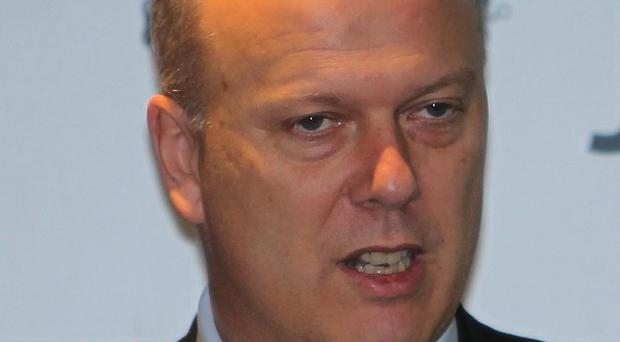 Chris Grayling says a committee will consider proposals for allowing convicted prisoners to take part in elections