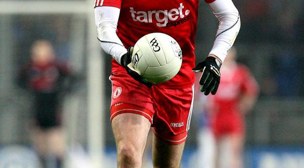 Hard times: Tyrone's Cathal McCarron has said he understands the anger at possible cuts to player grants