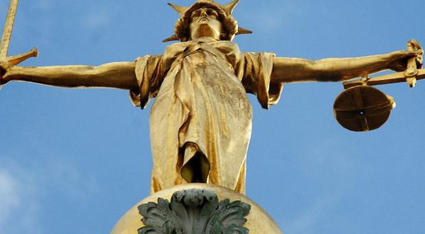 A man who punched a 16-year-old girl to the ground in east London has admitted assault