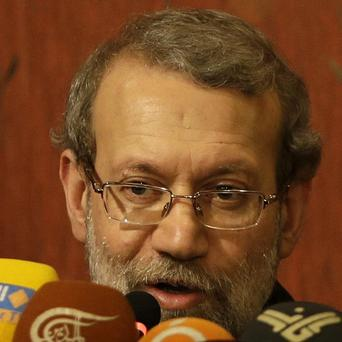 Ali Larijani, who met Syrian president Bashar Assad in Damascus, said Iran is seeking a peaceful solution to the war in Syria (AP)