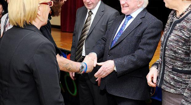 Michael D Higgins with his wife Sabina meeting members during their visit to St Michael's Irish Centre, as part of his visit to Liverpool