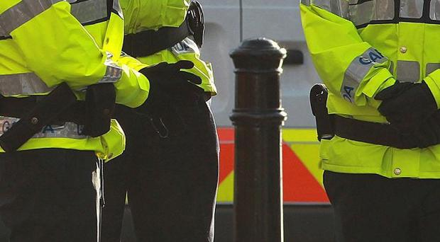 Gardai are investigating after a woman was tied up during a raid on her home