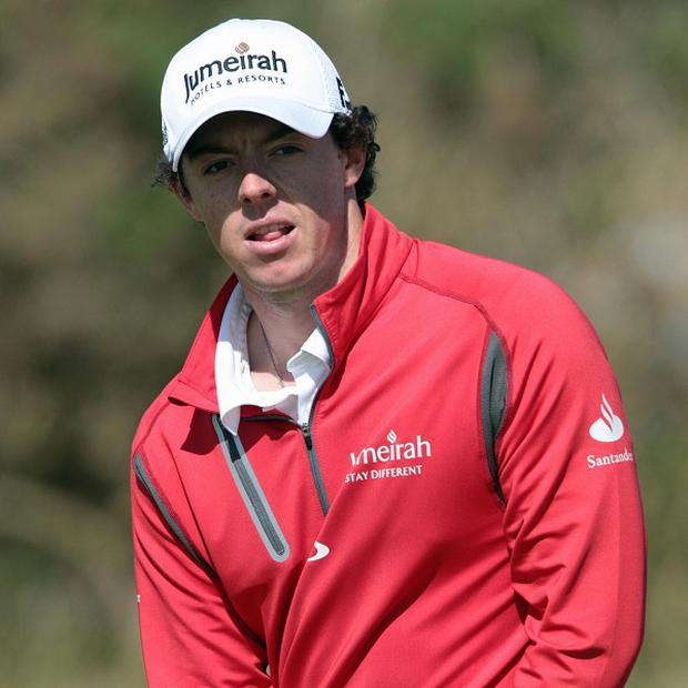 Rory McIlroy, pictured, joined Luke Donald and Marc Warren in a tie for the lead