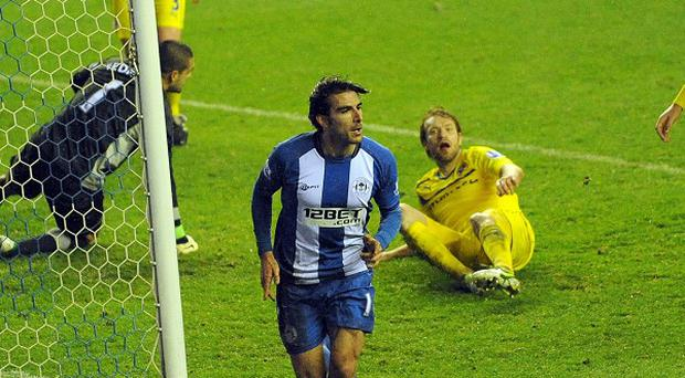 Jordi Gomez, centre, celebrates scoring his second goal