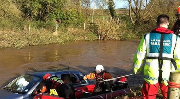 Three elderly people were rescued from their car after it was swept away as they drove into a ford in Warwickshire (West Midlands Ambulance Service/PA)