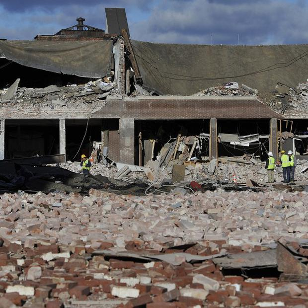Inspectors assess damage around the blast area in the US city of Springfield, Massachusetts (AP)