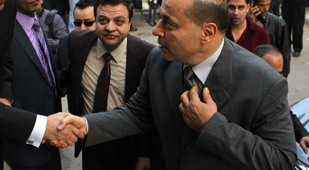 Newly appointed Egyptian prosecutor general, Talaat Abdullah, arrives for work after being appointed by president Mohammed Morsi. (AP)
