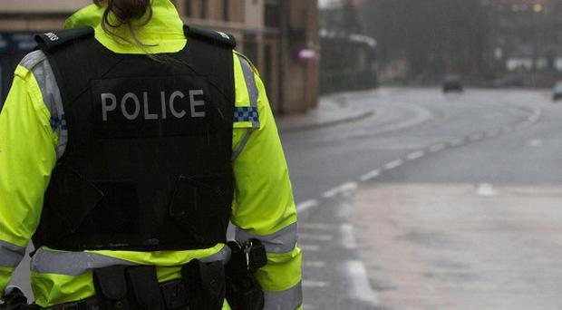 Three men armed with axes have held up a credit union in South Armagh