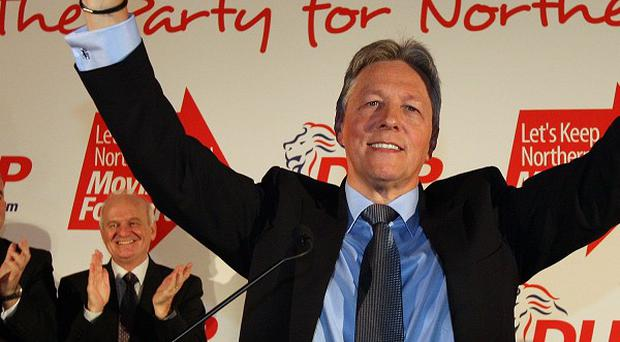 DUP leader Peter Robinson was giving a standing ovation at the party's annual conference in Belfast