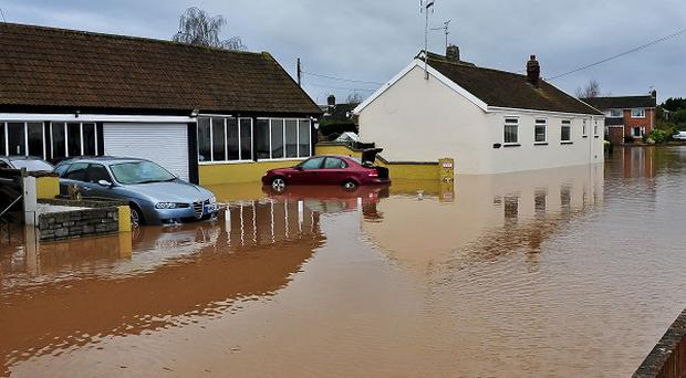 Homes are left flooded on Cheats Road in the Somerset village of Ruishton after the River Tone burst its banks