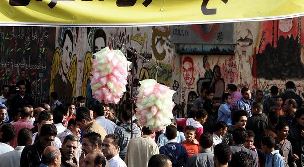 President Mohammed Morsi's edicts have sparked protests across Egypt (AP)