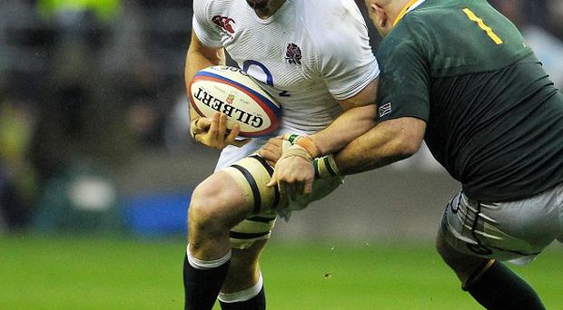 Sir Clive Woodward has backed Chris Robshaw, white, as England captain