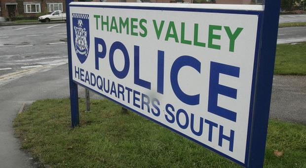 Thames Valley Police are investigating after an elderly woman was found dead in the same property as a man who had suffered multiple injuries