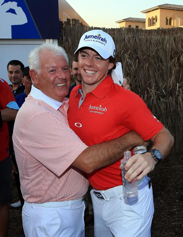 DUBAI, UNITED ARAB EMIRATES - NOVEMBER 25: Rory McIlroy of Northern Ireland is congratulated by his father Gerry McIlroy after his win during the final round of the 2012 DP World Tour Championship on the Earth Course at Jumeirah Golf Estates on November 25, 2012 in Dubai, United Arab Emirates. (Photo by David Cannon/Getty Images)