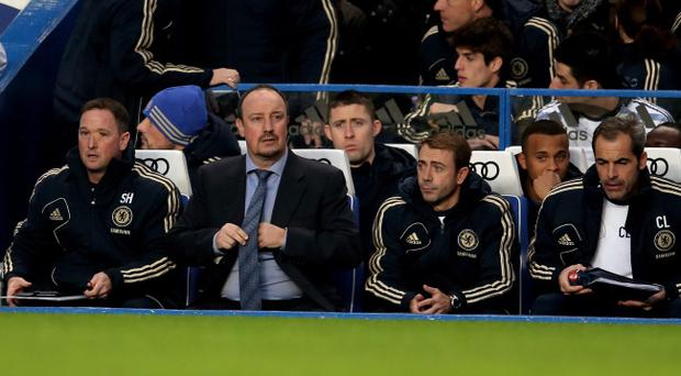 LONDON, ENGLAND - NOVEMBER 25: New Chelsea manager Rafael Benitez (2nd L) takes his place in the team dug out during the Barclays Premier League match between Chelsea and Manchester City at Stamford Bridge on November 25, 2012 in London, England. (Photo by Julian Finney/Getty Images)