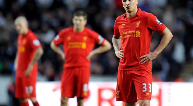 Liverpool's Jonjo Shelvey (right) and his team-mates stand dejected during the Barclays Premier League match at the Liberty Stadium, Swansea