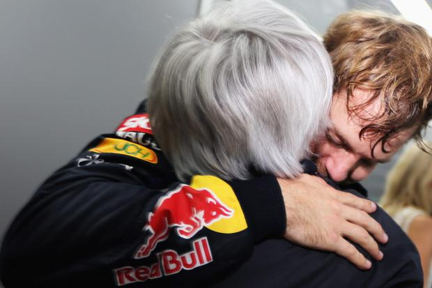 SAO PAULO, BRAZIL - NOVEMBER 25: Sebastian Vettel of Germany and Red Bull Racing celebrates in his changing room with F1 supremo Bernie Ecclestone as he finishes in sixth position and clinches the drivers world championship during the Brazilian Formula One Grand Prix at the Autodromo Jose Carlos Pace on November 25, 2012 in Sao Paulo, Brazil. (Photo by Mark Thompson/Getty Images)