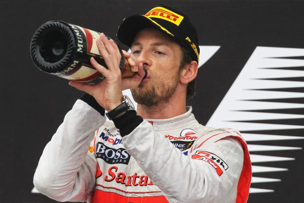 SAO PAULO, BRAZIL - NOVEMBER 25: Jenson Button of Great Britain and McLaren celebrates on the podium after winning the Brazilian Formula One Grand Prix at the Autodromo Jose Carlos Pace on November 25, 2012 in Sao Paulo, Brazil. (Photo by Ker Robertson/Getty Images)