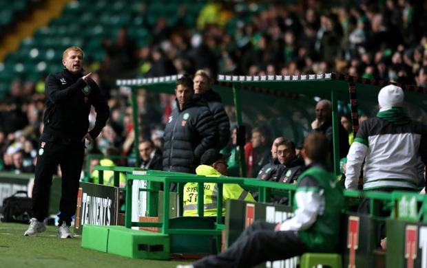 Celtic manager Neil Lennon argues with a Celtic fan seated near the dugout during the Clydesdale Bank Scottish Premier League match against Inverness at Celtic Park