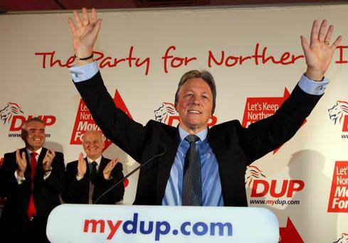 DUP leader Peter Robinson is given a standing ovation at the party's annual conference at La Mon House Hotel outside Belfast on Saturday