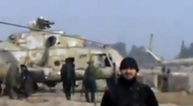 Image taken from video showing Syrian rebels capturing a helicopter base near Damascus (AP/Ugarit News)