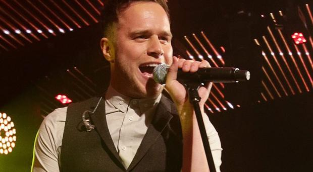 Olly Murs is celebratring his fourth number one single