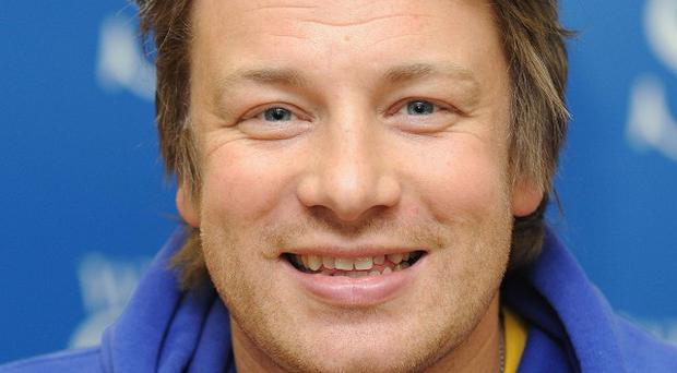 Chef Jamie Oliver has hit out at the Education Secretary
