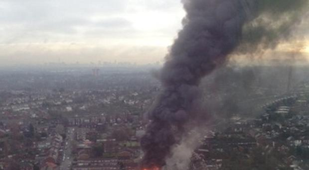 The fire destroyed the gin distillery in Langley (West Midlands Ambulance Service/PA)
