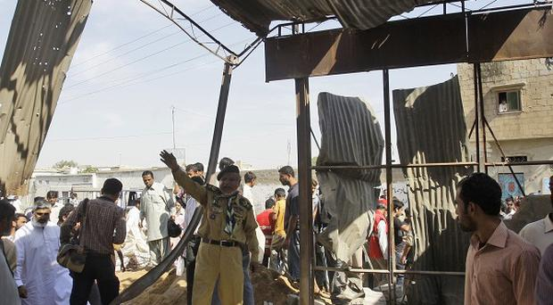 The aftermath of a terrorist bombing in Karachi (AP)