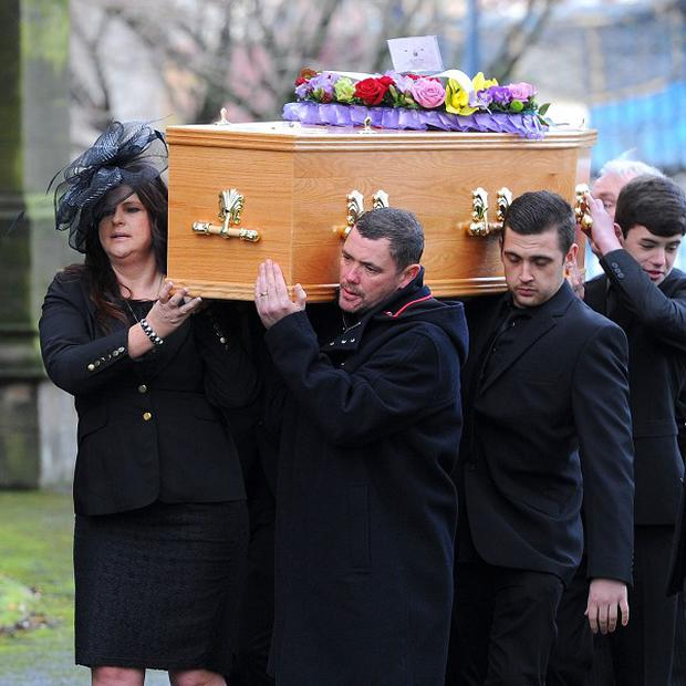 Pall bearers carry the coffin of Coronation Street star Bill Tarmey as it arrives at Albion United Reformed Church in Ashton-under-Lyne