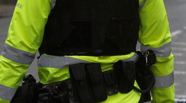 The PSNI appealed for witnesseses after a woman fell from a block of flats in west Belfast