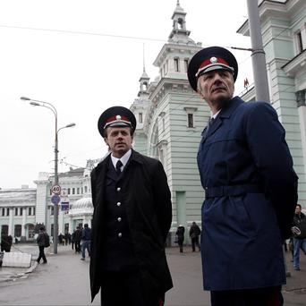 Cossacks are being used in a police role in a Moscow experiment (AP)