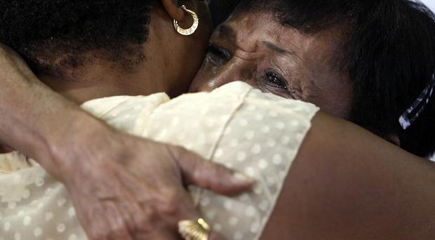 Maria Matias, mother of the former boxing champion Hector 'Macho' Camacho is embraced as she weeps at her son's memorial service (AP)