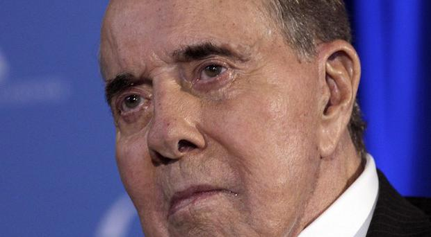 Former Senate Majority Leader Bob Dole has checked himself into Walter Reed Army Medical Centre (AP)