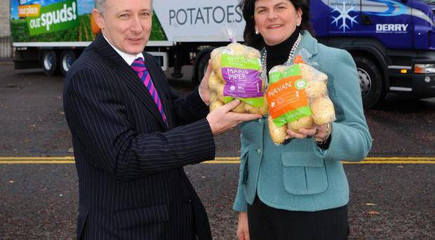 Enterprise Minister Arlene Foster congratulates Wilson's Country managing director Lewis Cunningham on the completion of a £1.5m development programme at the Co Armagh potato business