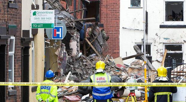 Andrew Partington has appeared at Manchester Crown Court to admit killing a young boy after causing an explosion in his house in Oldham