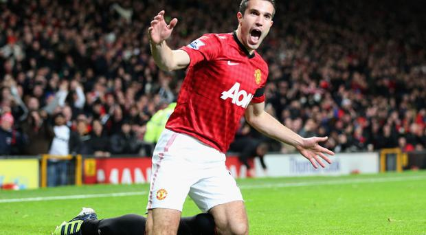 MANCHESTER, ENGLAND - NOVEMBER 28: Robin van Persie of Manchester United celebrates as he scores their first goal during the Barclays Premier League match between Manchester United and West Ham United at Old Trafford on November 28, 2012 in Manchester, England. (Photo by Clive Brunskill/Getty Images)