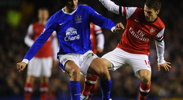 LIVERPOOL, ENGLAND - NOVEMBER 28: Marouane Fellaini of Everton competes with Aaron Ramsey of Arsenal during the Barclays Premier League match between Everton and Arsenal at Goodison Park on November 28, 2012 in Liverpool, England. (Photo by Laurence Griffiths/Getty Images)