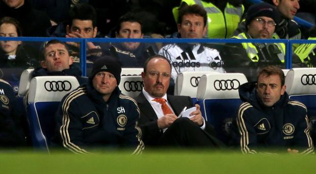 Chelsea interim manager Rafael Benitez (centre) on the touchline during the Barclays Premier League match against Fulham at Stamford Bridge