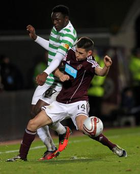 Celtic's Victor Wanyama is challenged by Kevin McHattie of Hearts last night