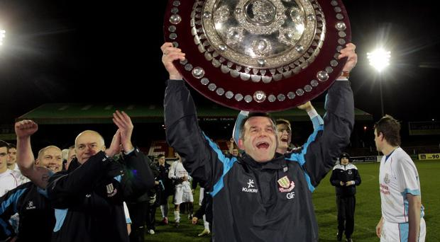 Glenn Ferguson lifts the Co Antrim Shield, his first trophy as a manager