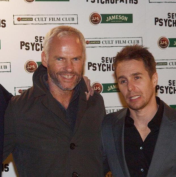 Producer Martin Broadbent, director Martin McDonagh and actor Sam Rockwell arrive at the premiere of Seven Psychopaths