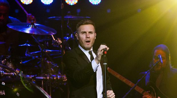 Gary Barlow was joined on stage by Robbie Williams