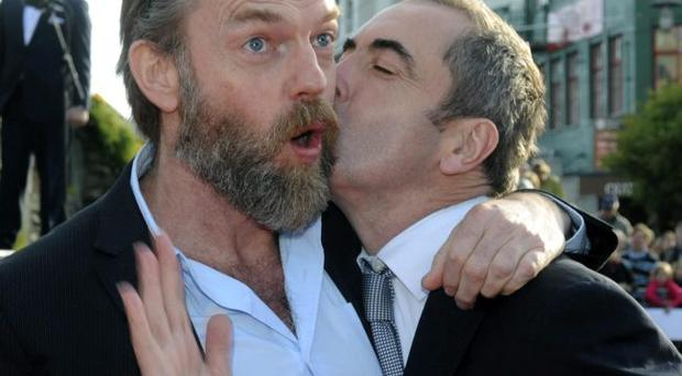 Cast members Hugo Weaving, left, and James Nesbitt pose on the red carpet at the premiere of