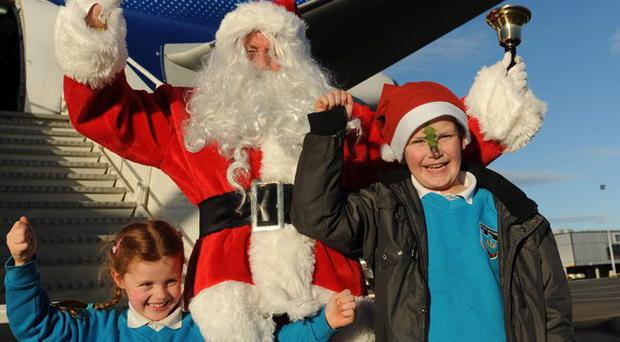 Chloe Crumley and Cameron Gilmore with Santa before boarding the Flight of Dreams