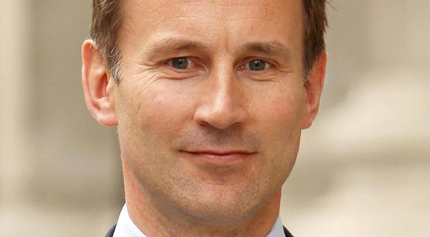 Jeremy Hunt has been criticised in the Leveson report over his handling of his special adviser Adam Smith