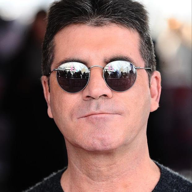 Is Simon Cowell hoping someone will pick up a penguin for him this Christmas?
