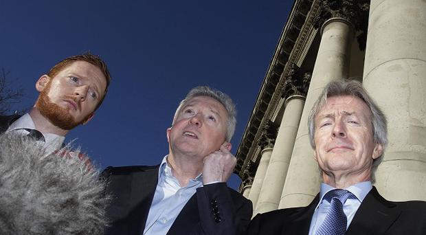X Factor judge Louis Walsh, centre, speaks to the media after his defamation case